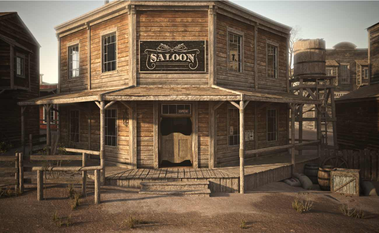 A Western town saloon with other businesses on either side