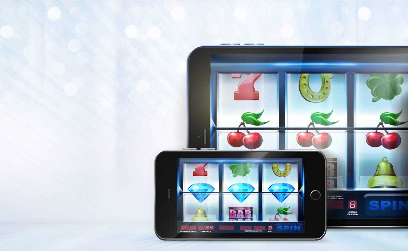 Tablet and iPhone displaying online slots game.