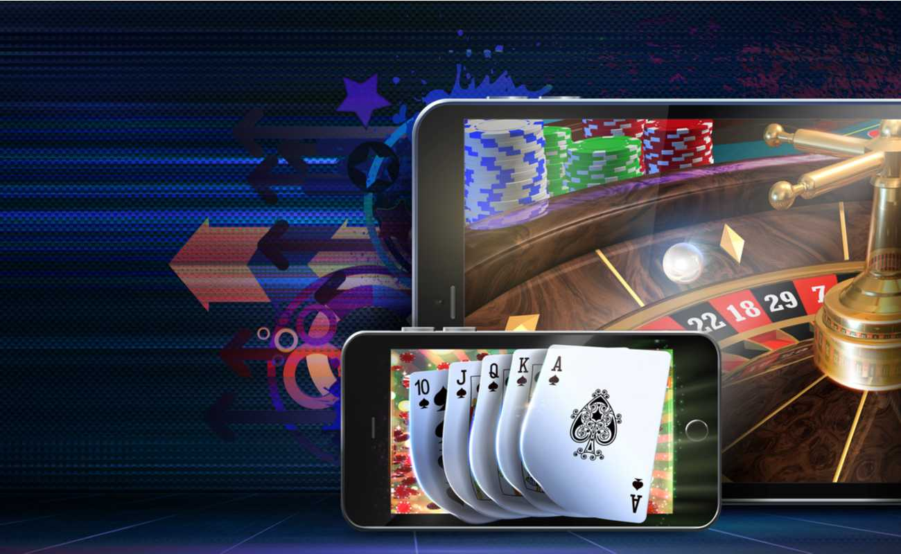 Tablet and iPhone displaying online roulette and poker.