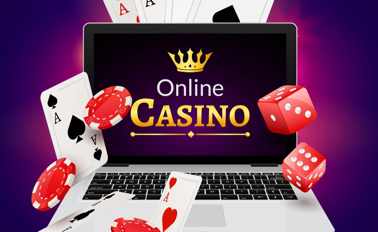 Laptop screen displaying online casino with cards, red dice and poker chips