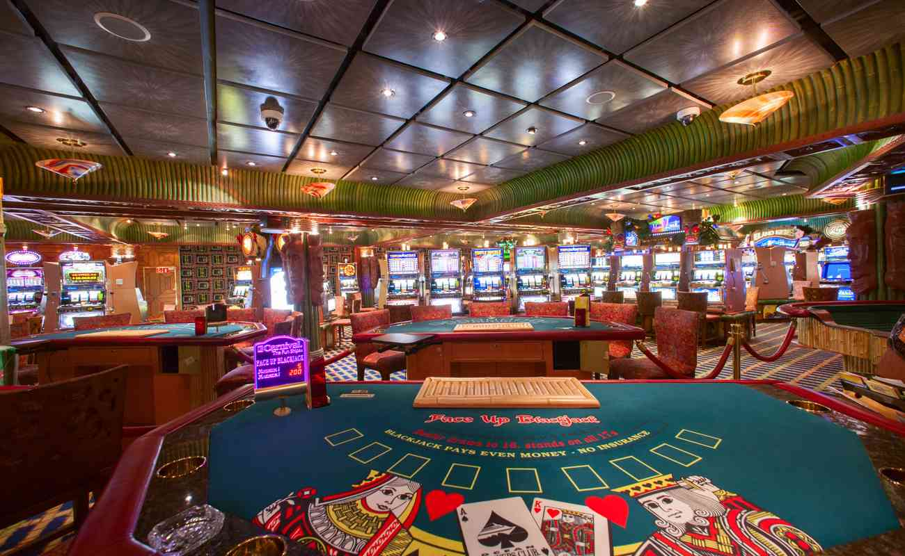 Empty colorful casino with poker tables and slot machines