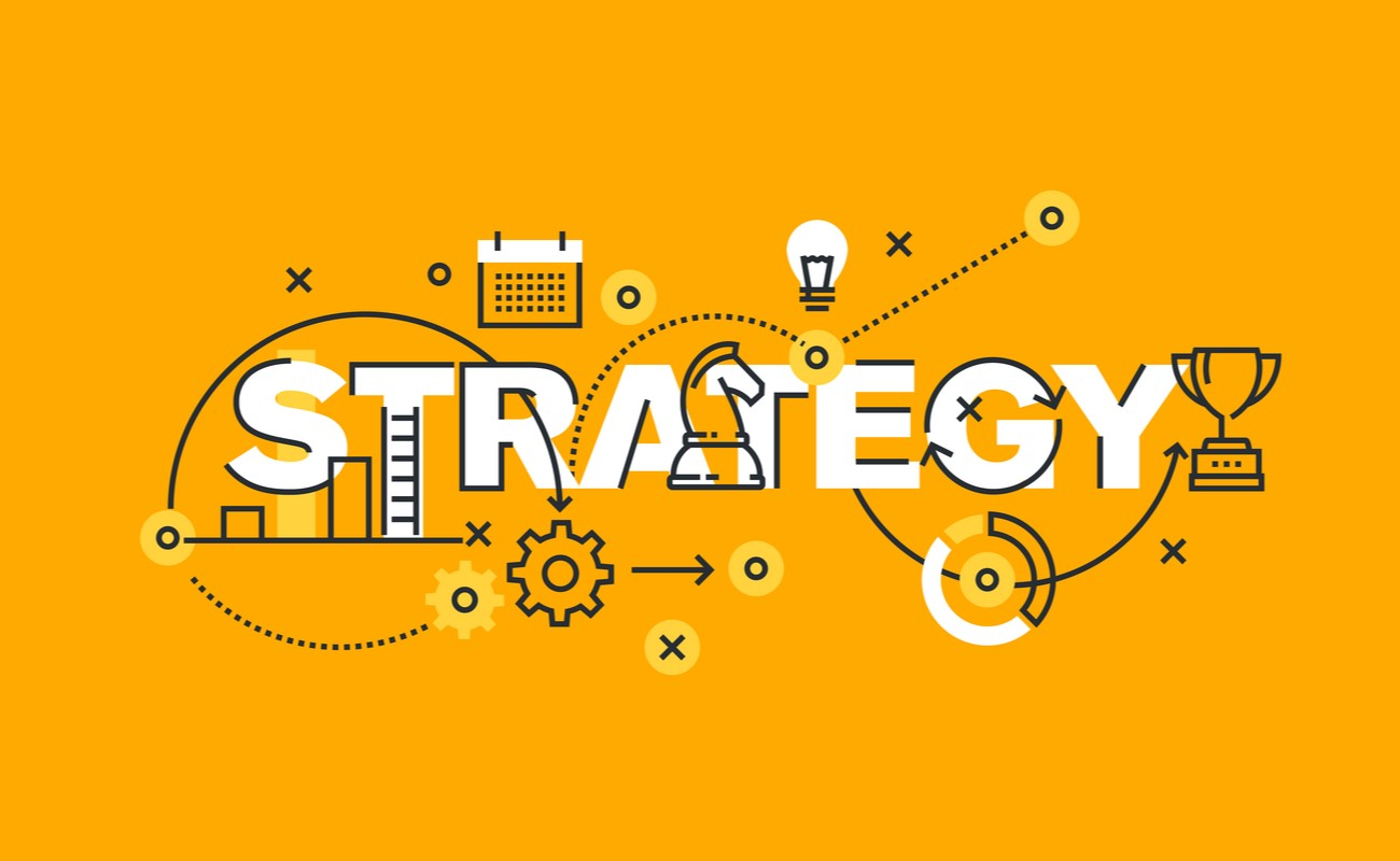 The word strategy written in a concept with cogs and other strategic items