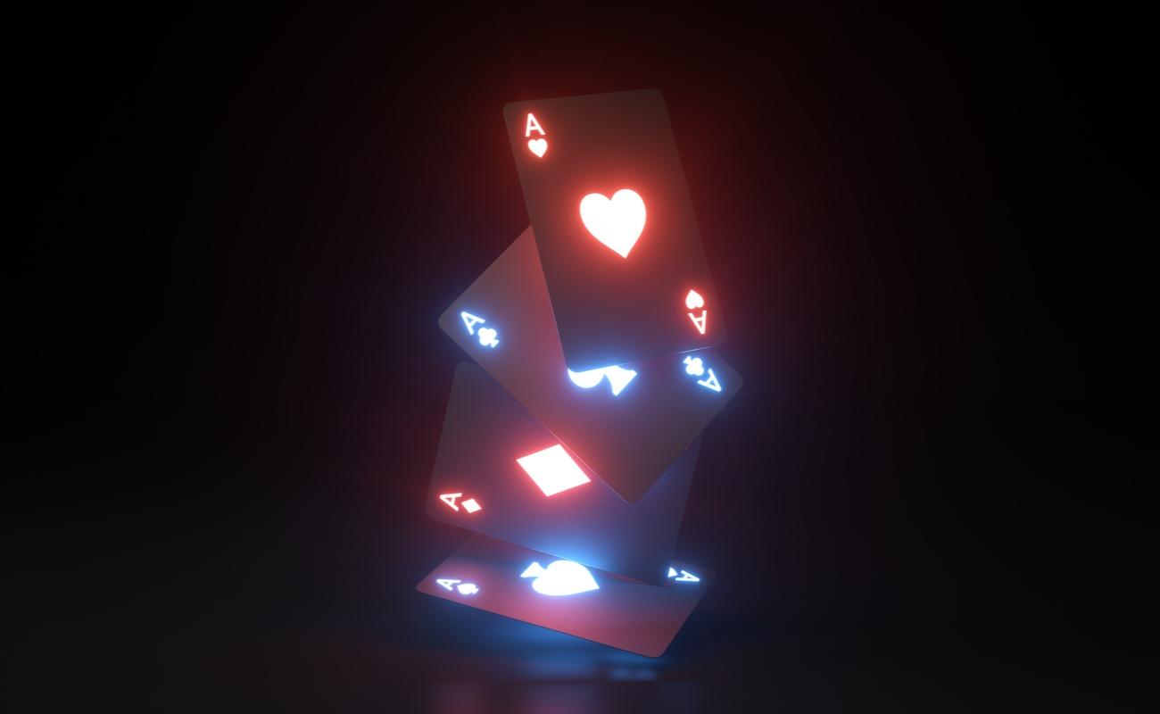 glowing playing cards falling against black background