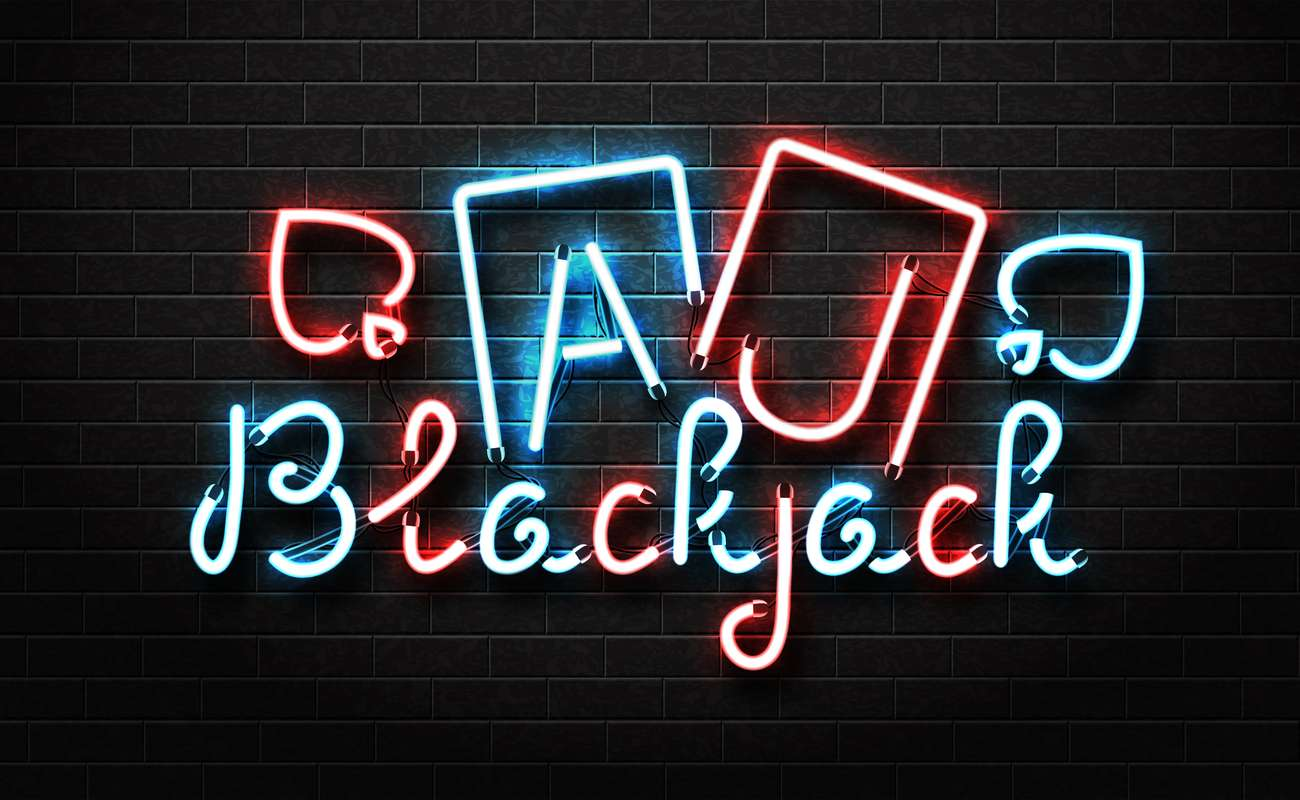the word blackjack and two playing cards written in neon as a wall sign