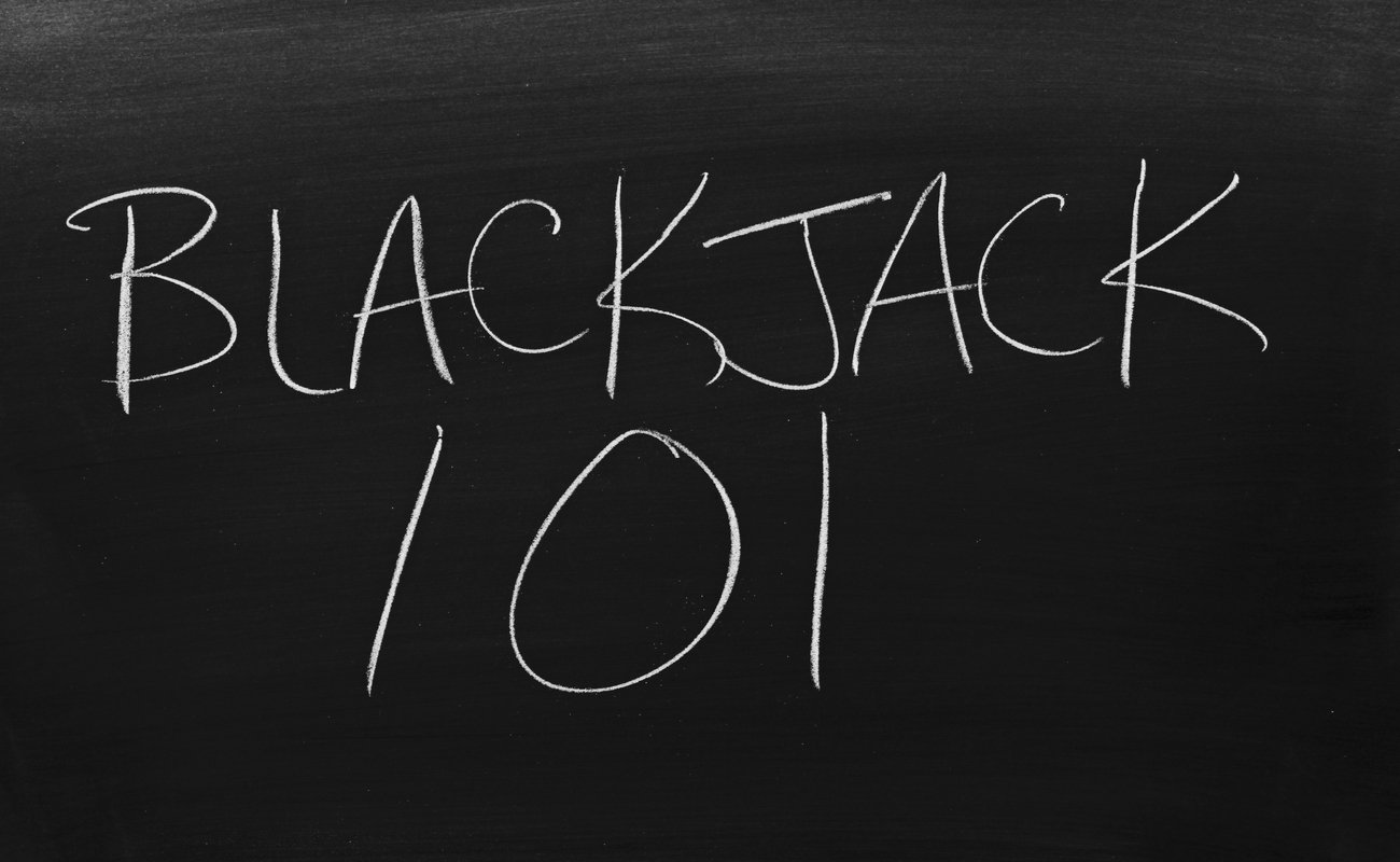 Blackjack 101 written on a blackboard with white chalk