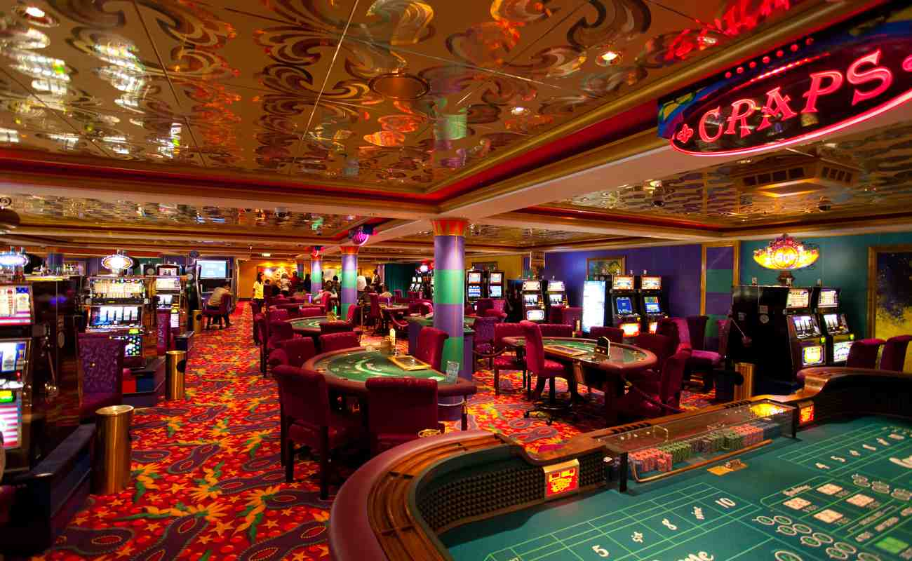 nside a casino with slot machines and poker tables
