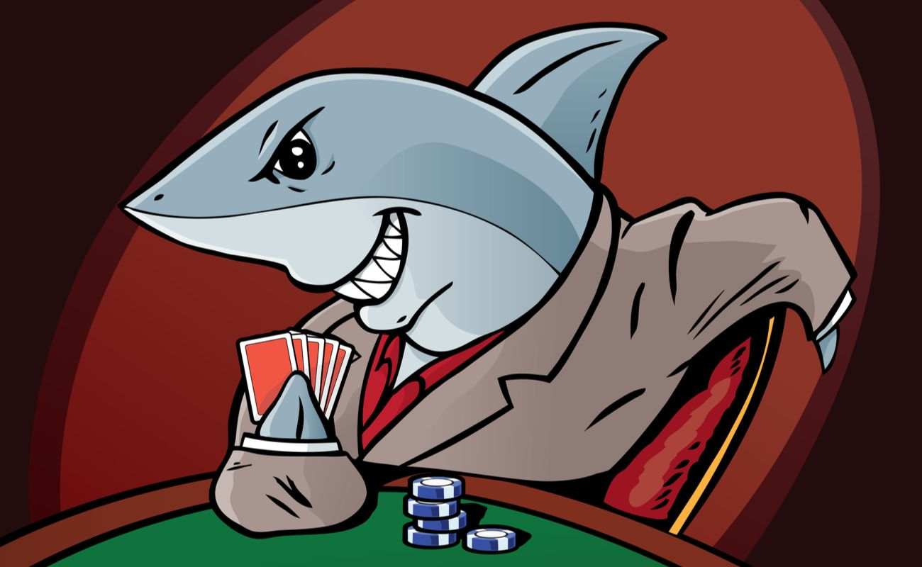 Cartoon shark in a suit holding playing cards and poker chips
