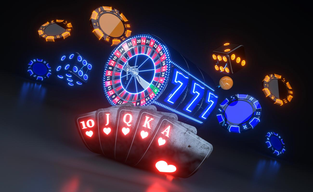 neon cards and poker chips and casino slots on dark background