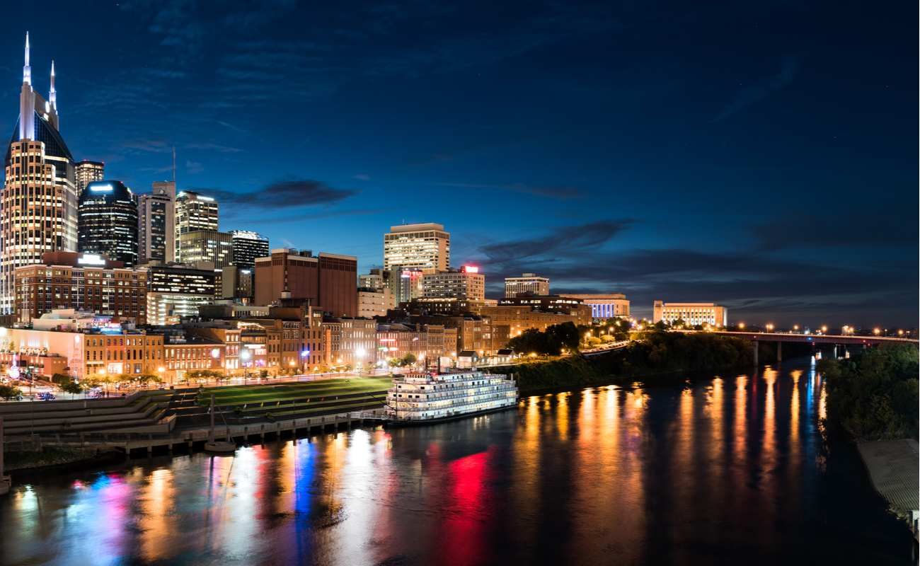 Blue Nashville Skyline at Dusk with Riverboat