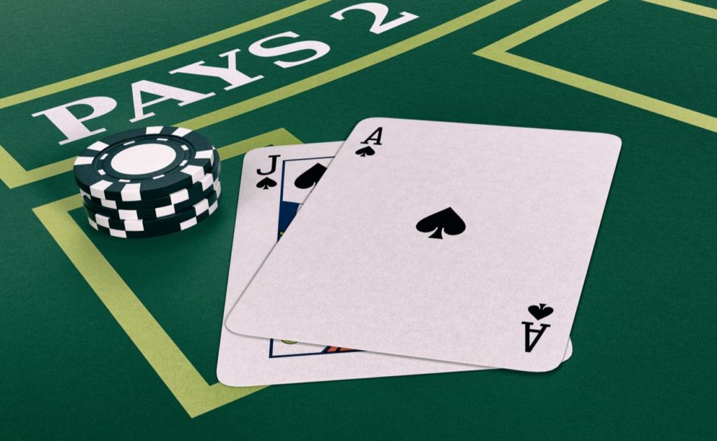 Jack and Ace card on green table with chips