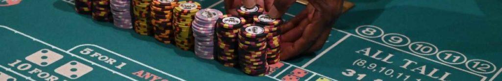 A craps dealer prepares stacks of casino chips
