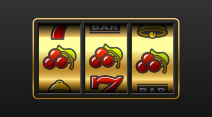 Vintage looking 3-wheel slot machine with three cherries in a row