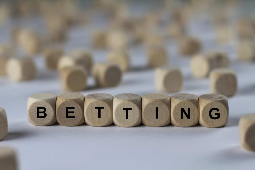 Betting letters written on wooden cubes