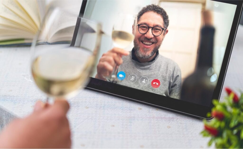 Friends drinking wine via online video call