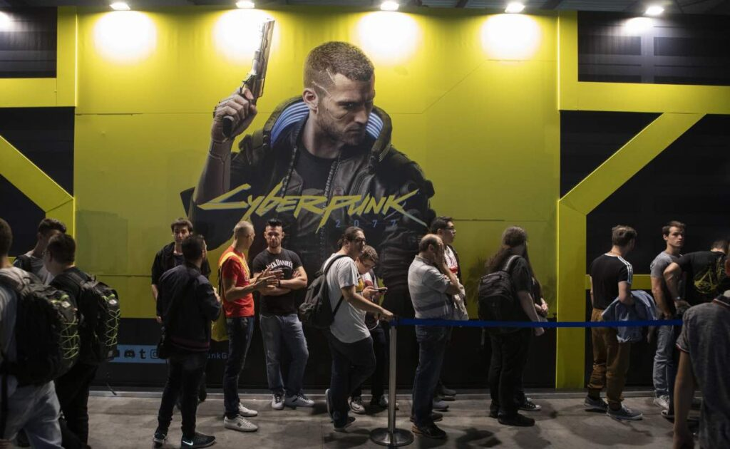 Fairgoers wait in line in front of Cyberpunk 2077's stand during the Milan Games Week September 2019