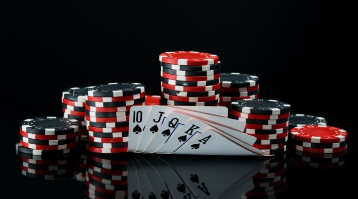 poker chips and cards on black surface and background