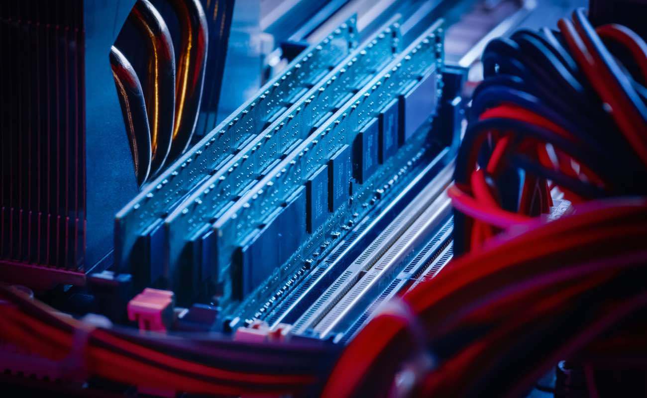 Close-up macro shot of installed RAM memory in computer motherboard slot. Shot in neon colors.