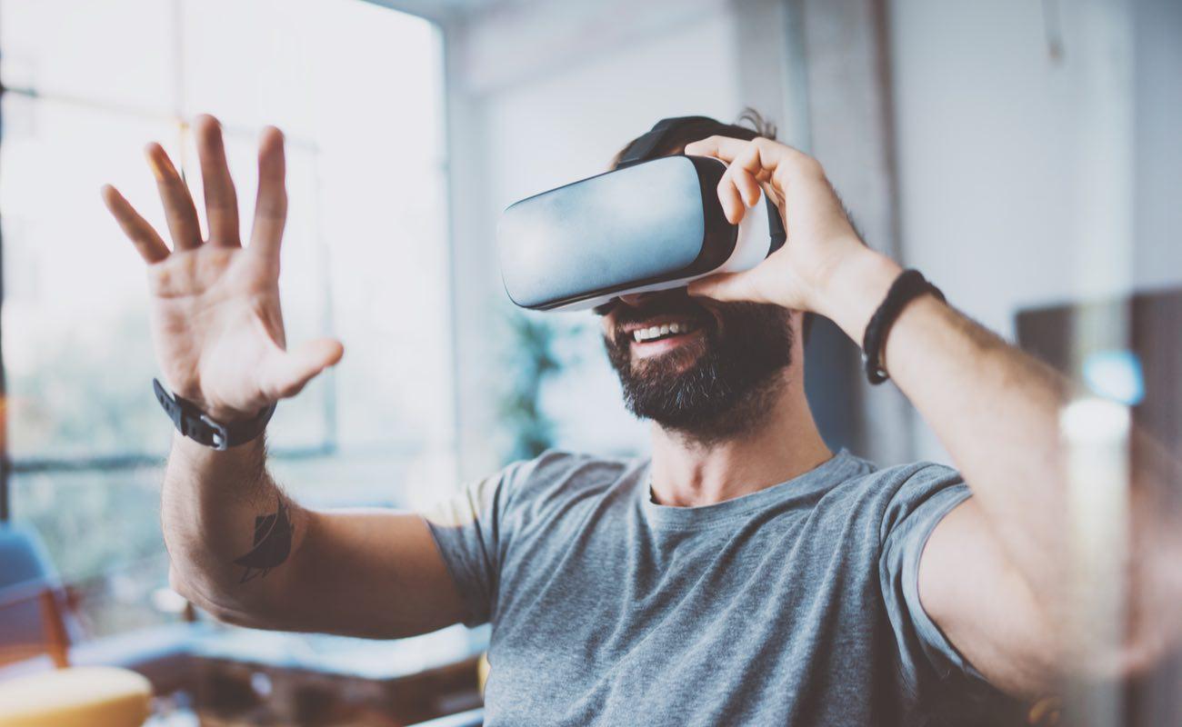 Man wearing virtual reality glasses in modern interior design studio
