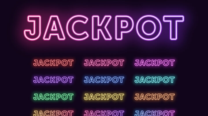 The word Jackpot lit up in a neon purple sign.