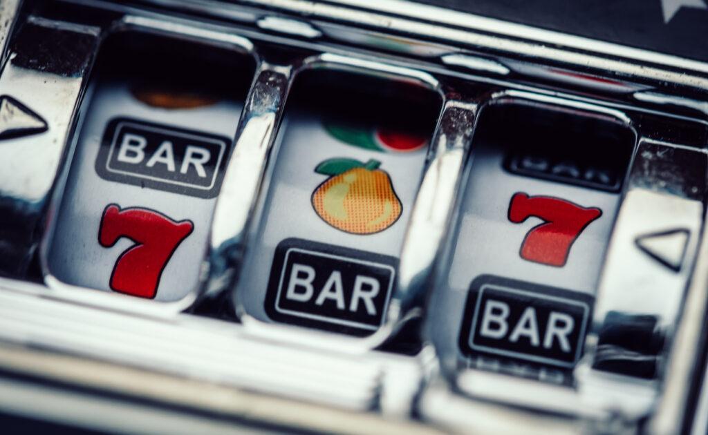 Closeup view of a casino slot machine's reels and symbols.