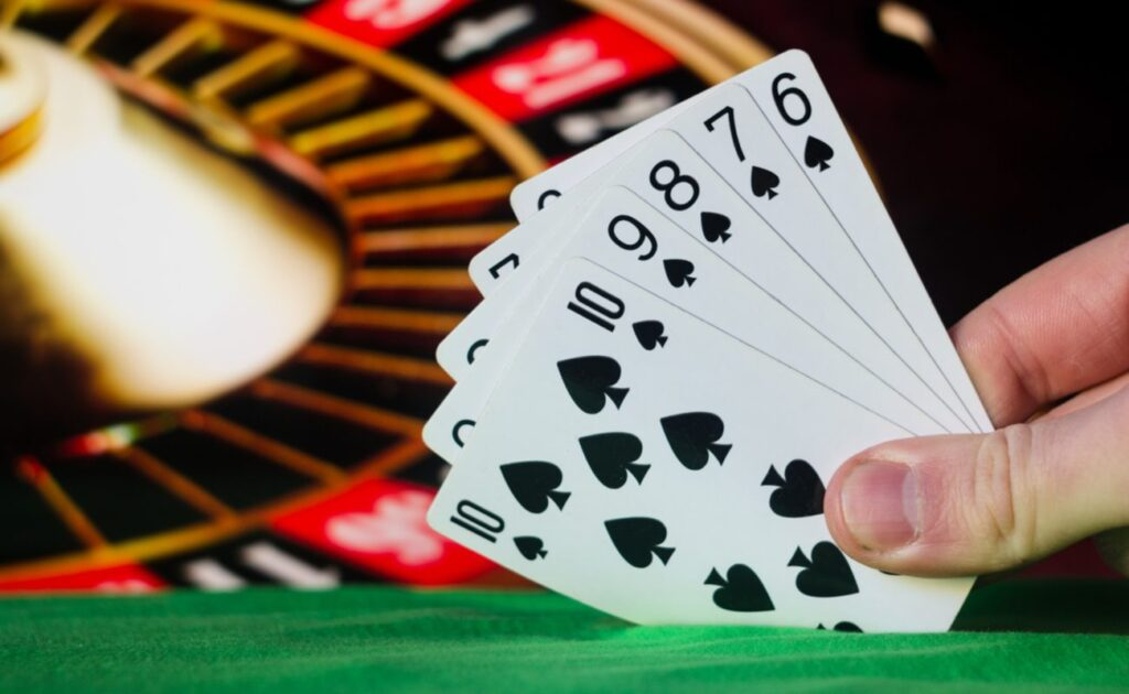 A player shows their straight-flush poker hand, starting from the six of spades and ending on the 10.