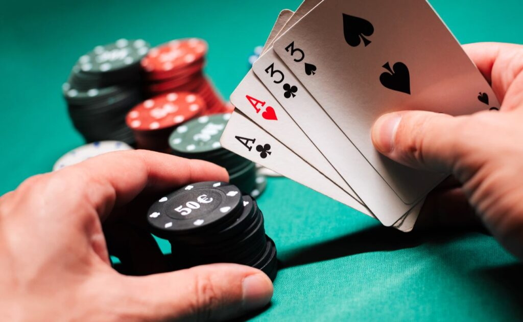 A player holds a pair of aces and threes in a regular game of poker.