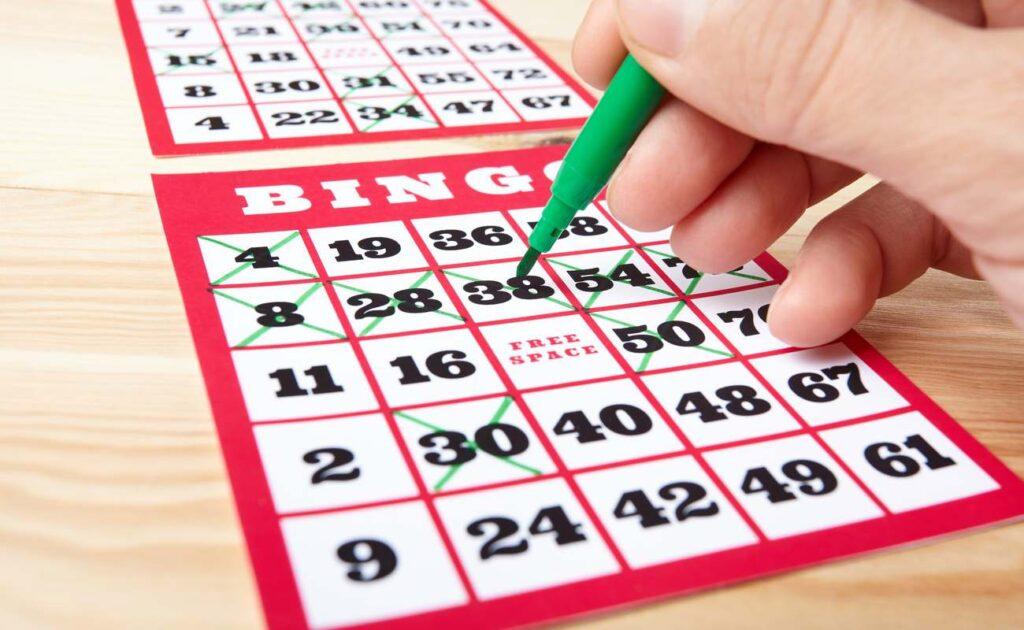 A bingo player marks off numbers on a bingo card.