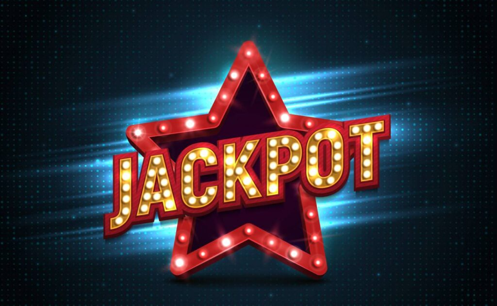 """The word """"jackpot"""" stands in front of a red star with lights flashing."""