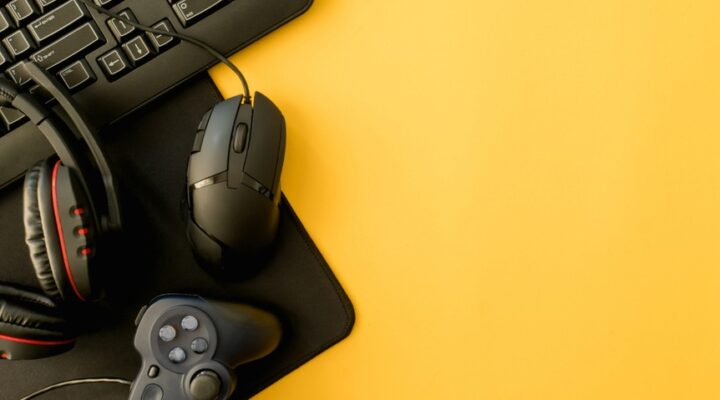 A video game controller sits on a yellow table.