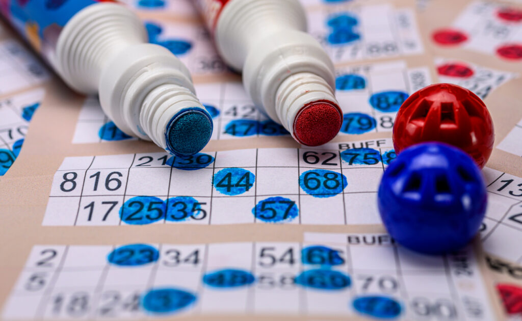 Bingo cards with red and blue markers.