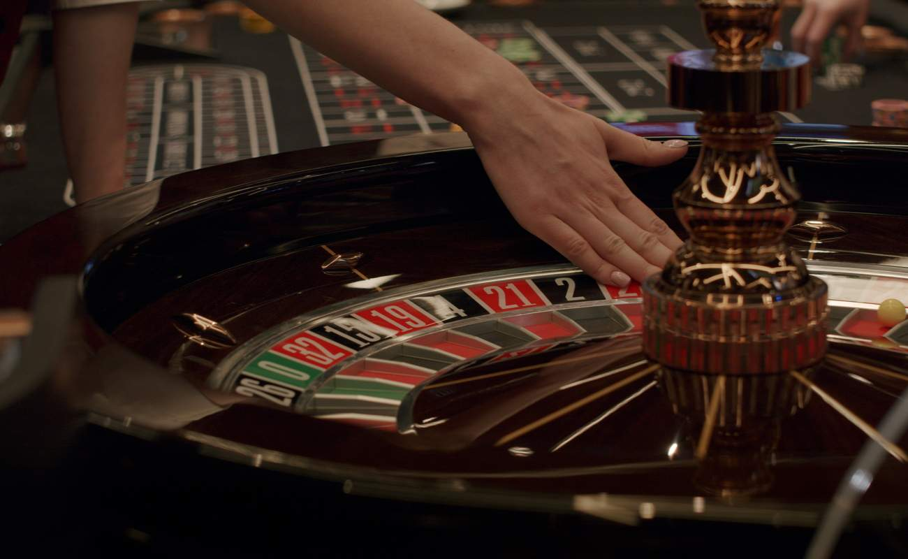 A woman's hand on a roulette table.