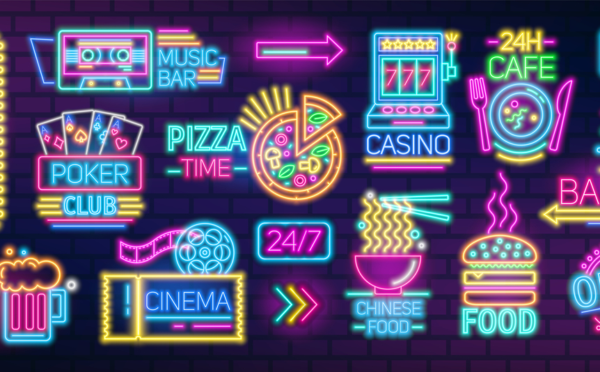 Neon colored signs and billboards containing food and casino symbols.