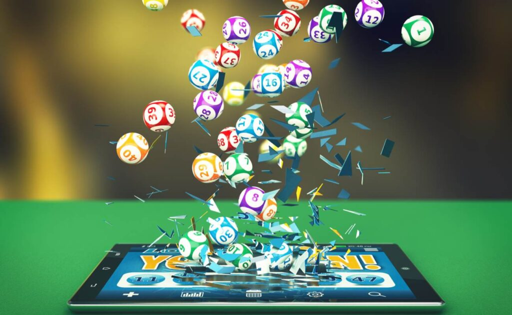 A digital render of bingo balls exploding out of a tablet screen.