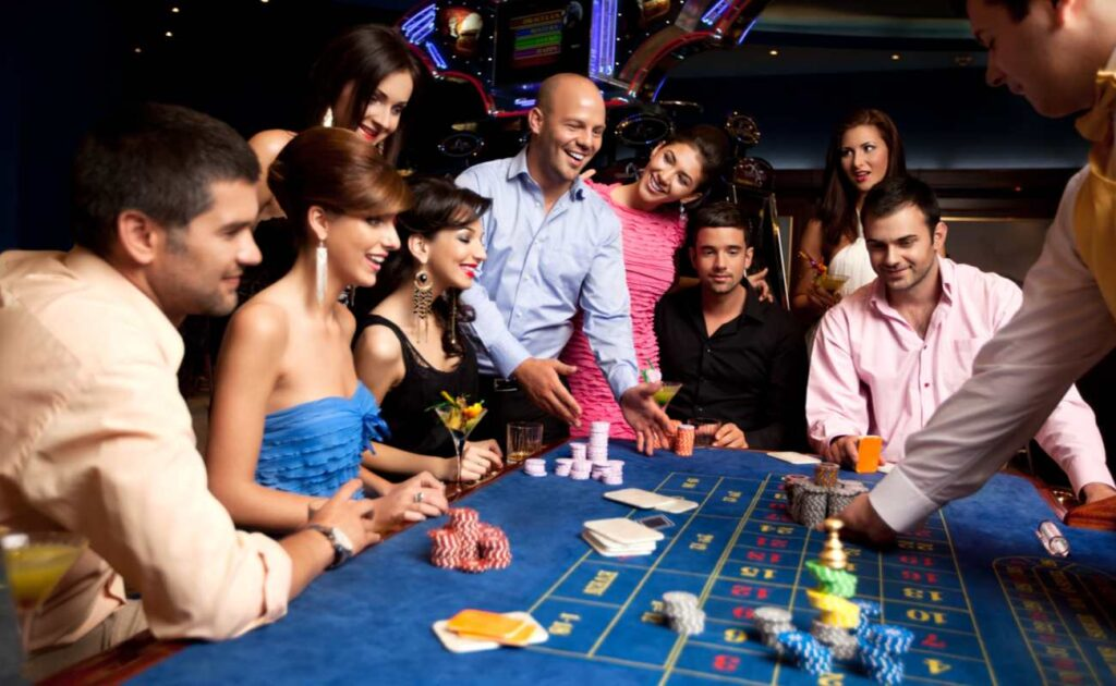 A group of people having a fun time gambling.