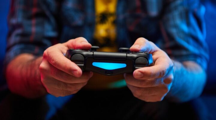 A man holds a video game controller.