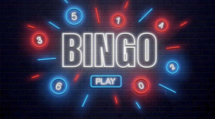 A neon 'bingo' sign on a black background.