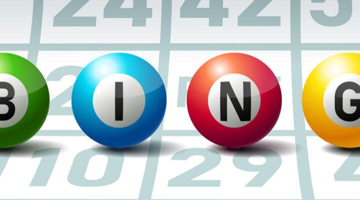 Bingo spelled out on bingo balls against a bingo card.