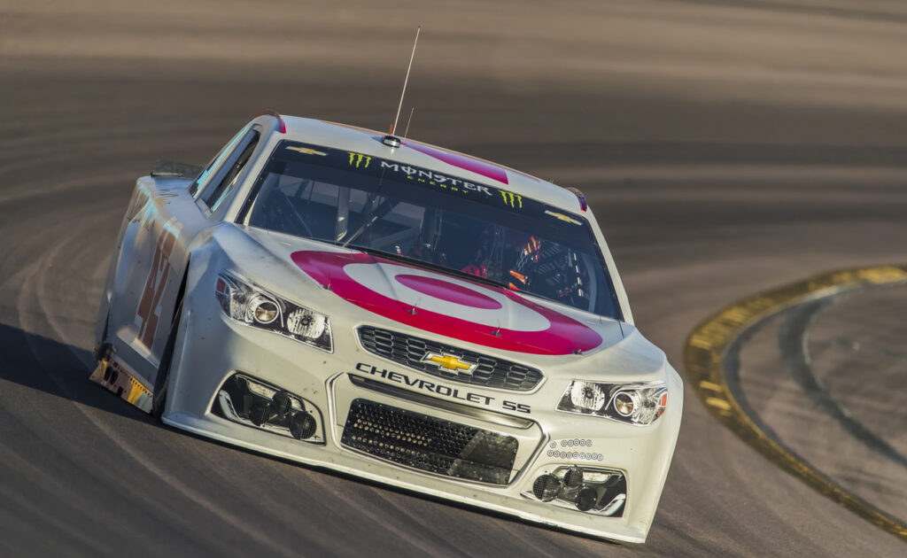 A Chevrolet car on the track in a NASCAR race.