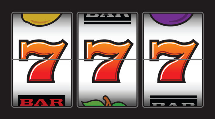 slot reel against grey background showing 3 red sevens - Las Vegas themed slots