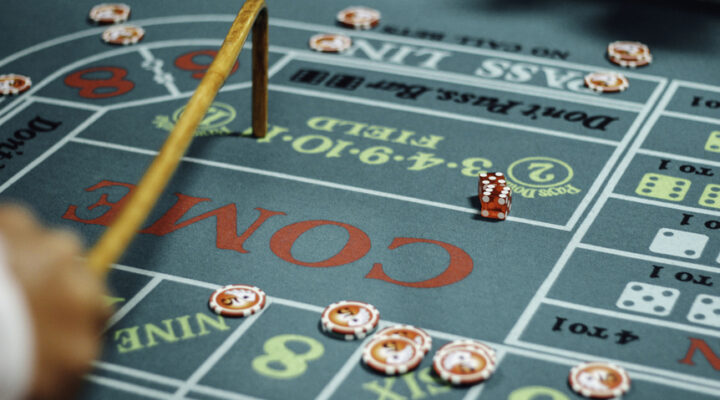 A partial view of a craps table with dice on it.