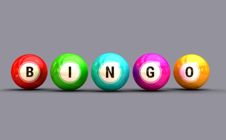 Line of colorful bingo balls spelling out the word, 'bingo.'