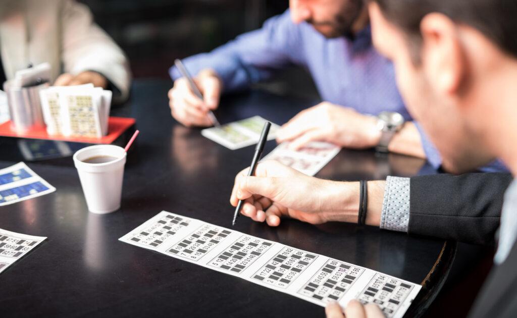 Players marking off bingo cards.