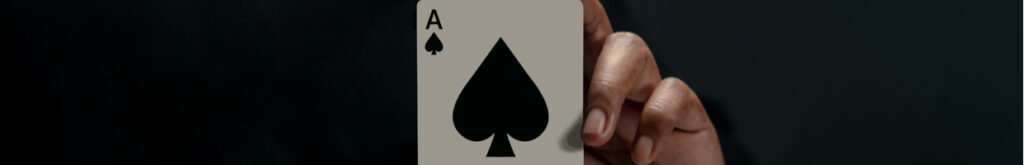 Ace playing card against a black background.