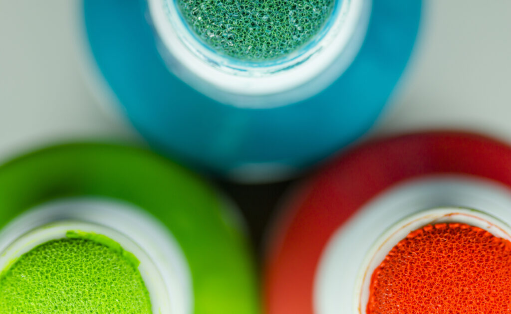 Image from above of blue, green, and red bingo daubers.