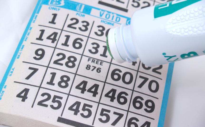 A dauber hovers above a bingo card.