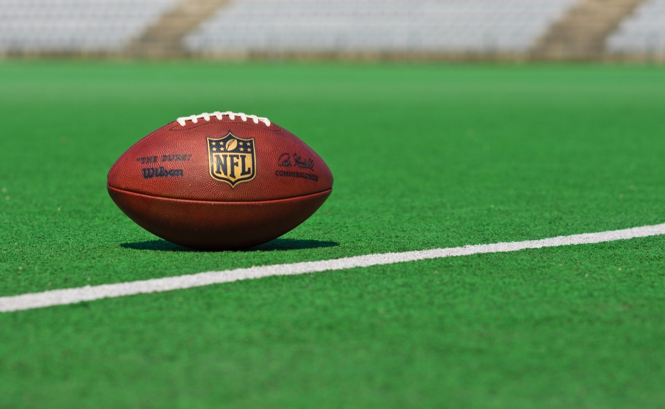 Official NFL football on a green football pitch