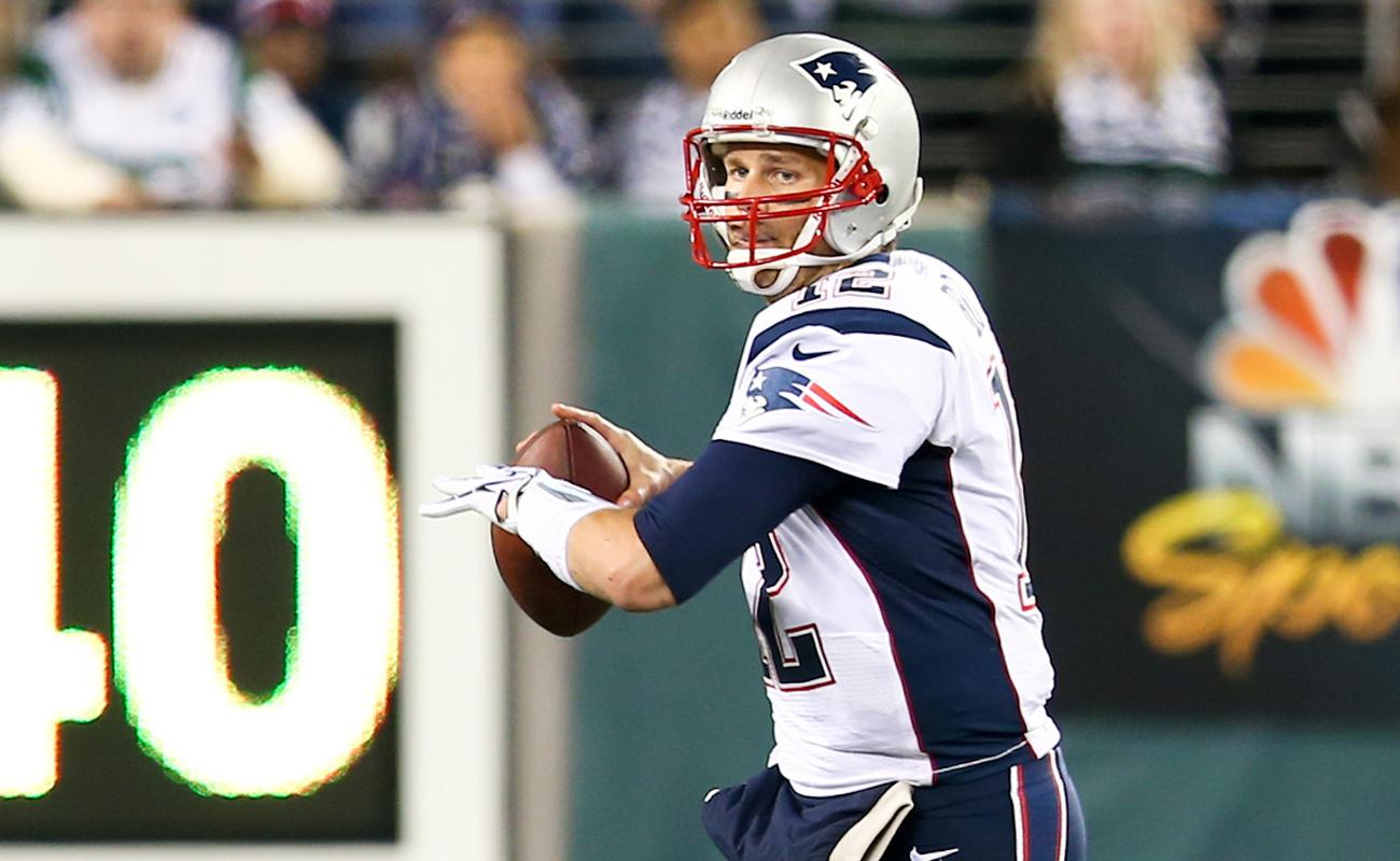 Tom Brady about to throw the football during a game