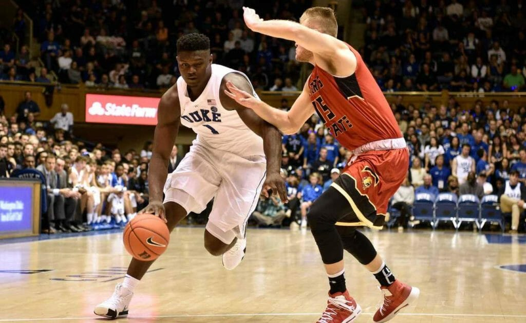 Zion Williamson #1 of the Duke Blue Devils drives against Greg Williams #15 of the Ferris State Bulldogs