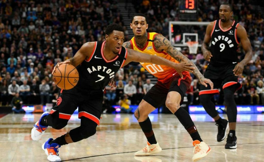 Kyle Lowry of Toronto Raptors drives past Jordan Clarkson of Utah Jazz during a game at Vivint Smart Home Arena