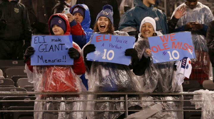 Young fans hold up signs for Eli Manning of the New York Giants in a game against the Philadelphia Eagles